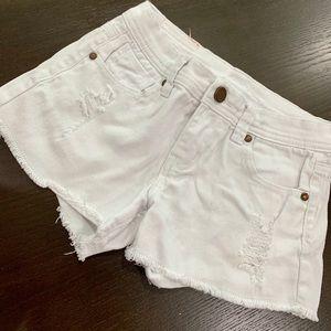 Girls destroyed style shorts.
